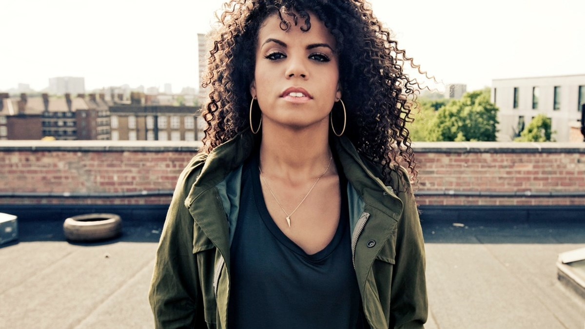 "HERITAGE: Ms. Dynamite Performs A Deeply Moving Acoustic Version Of ""Brother"" (2003)"